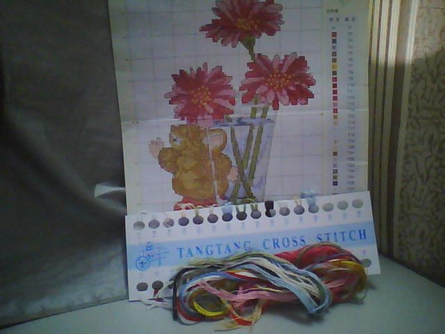 我的十字绣进程日记 10月5日第一朵绣好了,努力努力