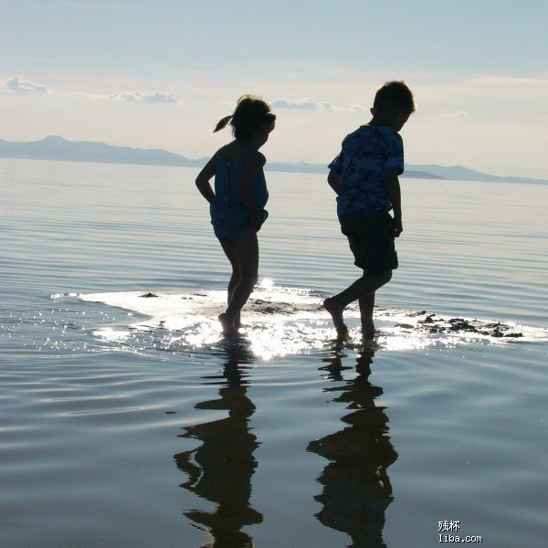 children-walking-water-river-reflective-surfaces.jpg